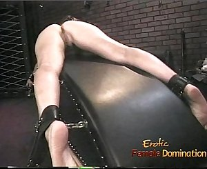 Attractive brown-haired filly loves having her butt and her feet whipped