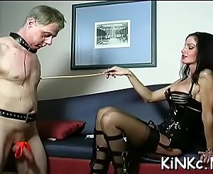 Wicked mistress ties up slave's ball sack and whips booty bloody