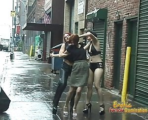 Two bints pleasure a stunning dark-haired on the middle of the street